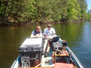 a. Learning the ways of the FLAMe: Kevin Gauthier and Mike Smale are mapping water chemistry of northern WI lakes, summer 2018'